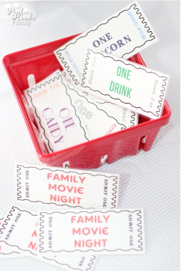 family movie night tickets and concession stand tickets in a basket
