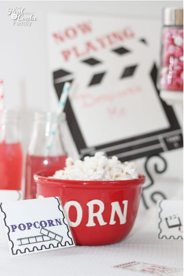 bowl of popcorn with printable paper popcorn tag next to it