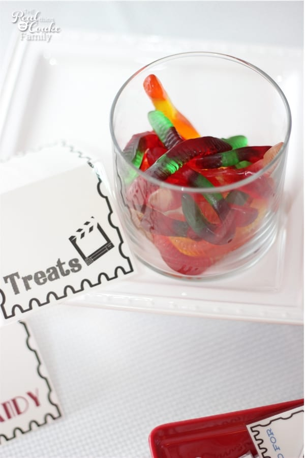gummy worms in a jar with a printable treats tag next to it