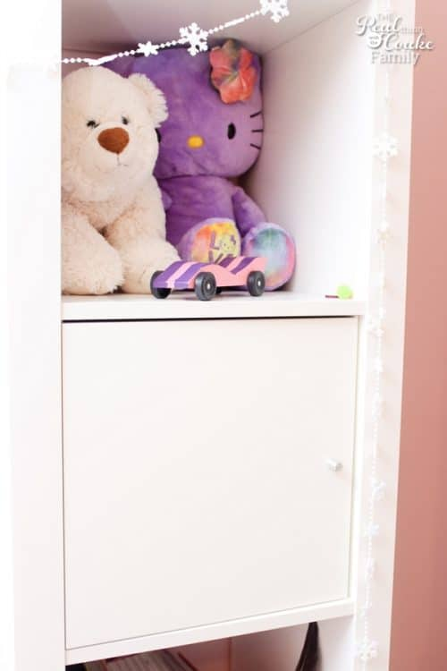 Genius shelving unit and desk using an IKEA Expedit. Perfect storage solution for a child's room, entertainment center, or home office.