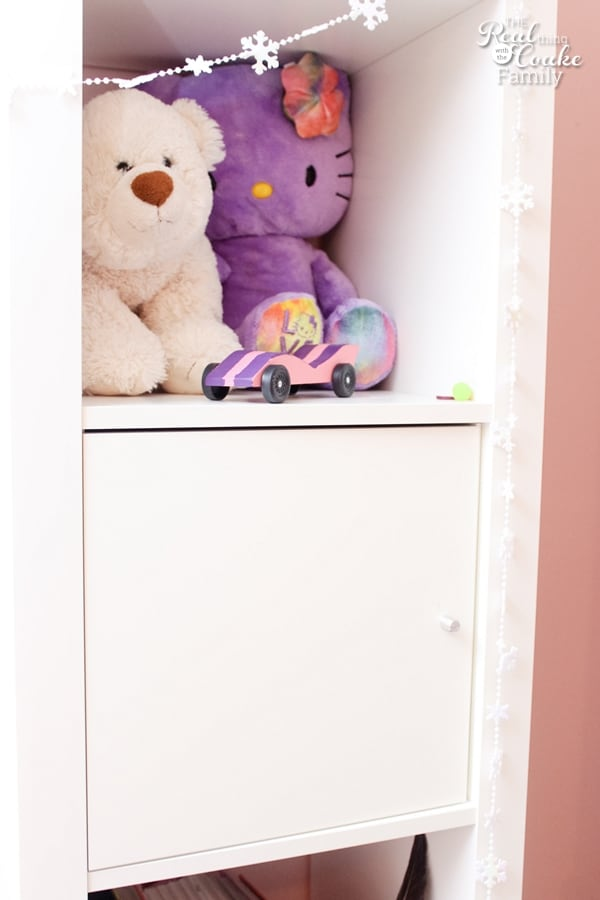 Stuffed animals sitting on shelf of IKEA built in hack
