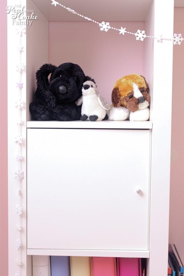 Stuffed animals on the shelf to an IKEA Expedit