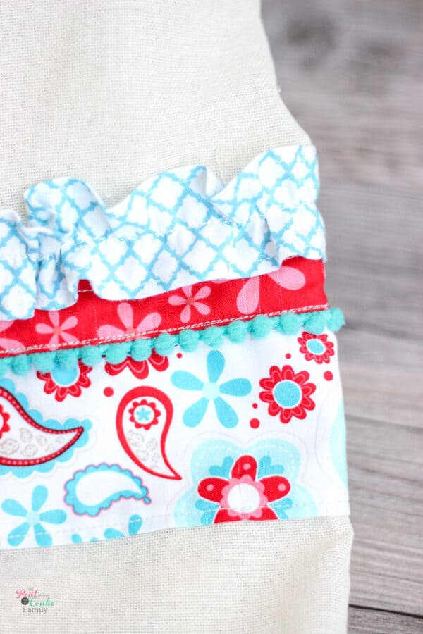 close up of decorative fabric on flour sack towel
