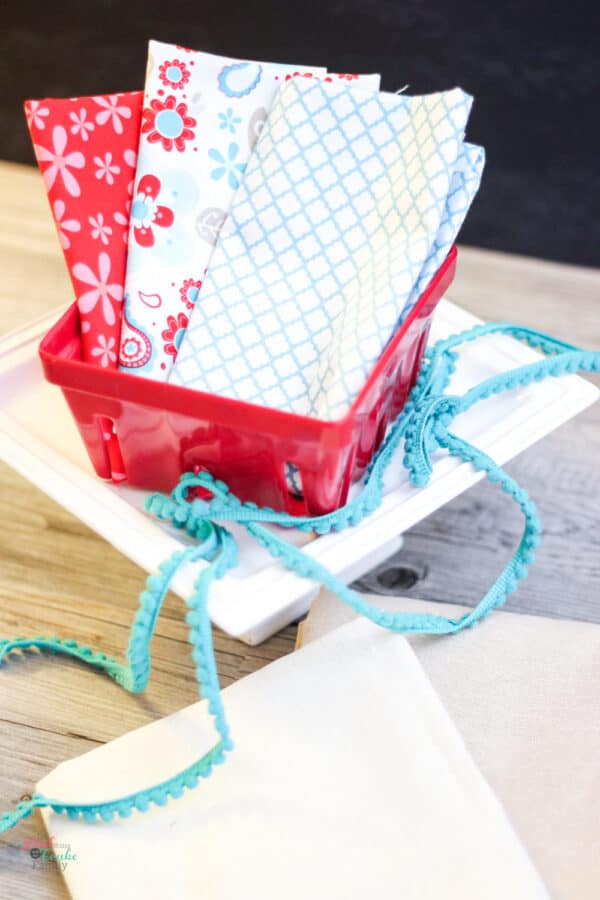 supplies needed - fabric in basket with pom pom fringe