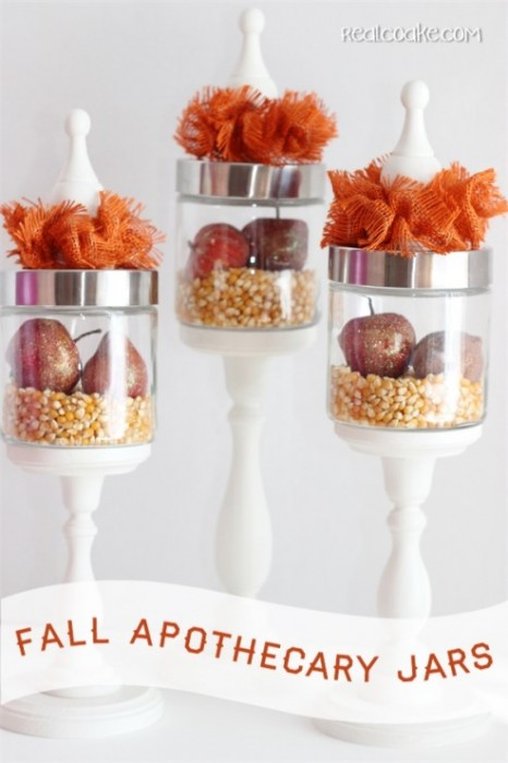 apothecary jars filled with popcorn and fall fruit