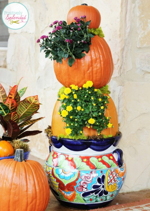 pumpkin tower in a pot with mums in the pumpkins