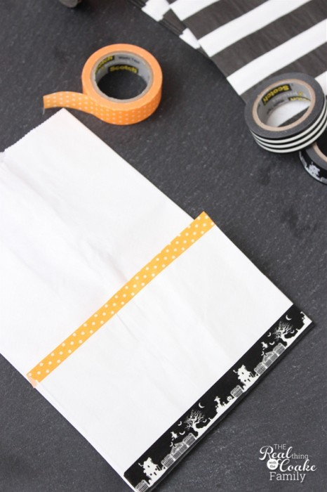 Super cute and easy Halloween party idea to make these adorable kits with napkins and utensils. Must make these!