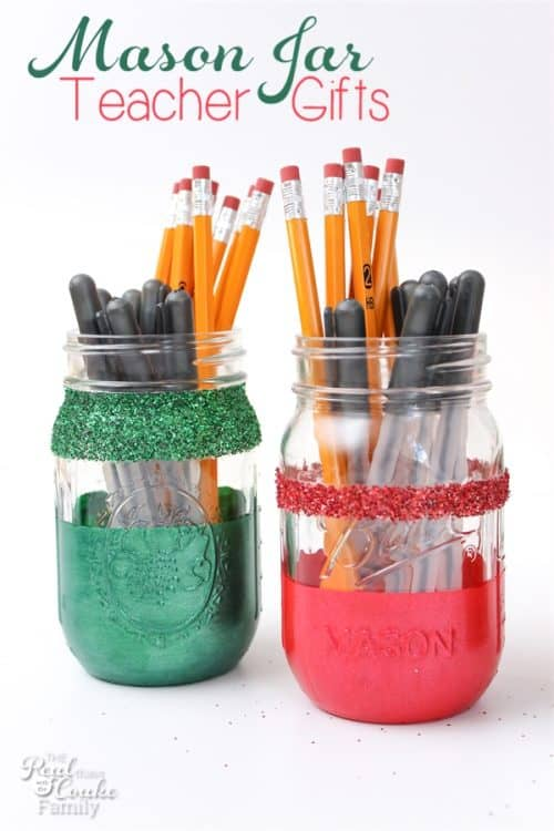 Love these DIY glittery Christmas mason jars. They are so pretty and look filled with pens and pencils for a teacher gift.