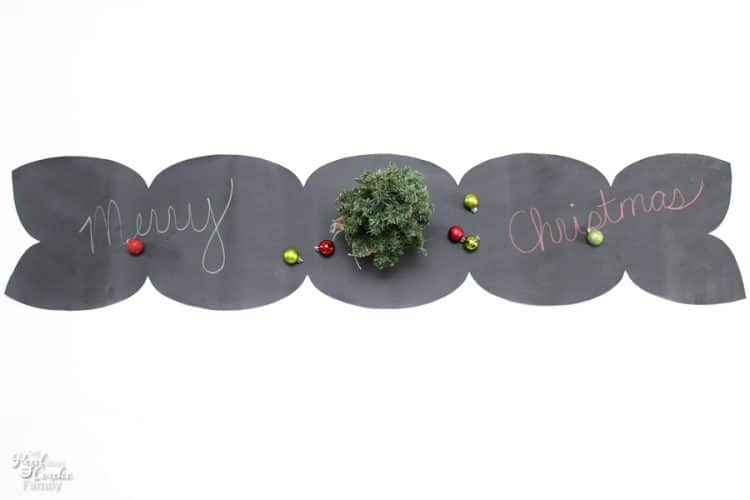 I love this DIY Chalkboard table runner! So pretty and could be used in our Christmas decorations or any time of year.