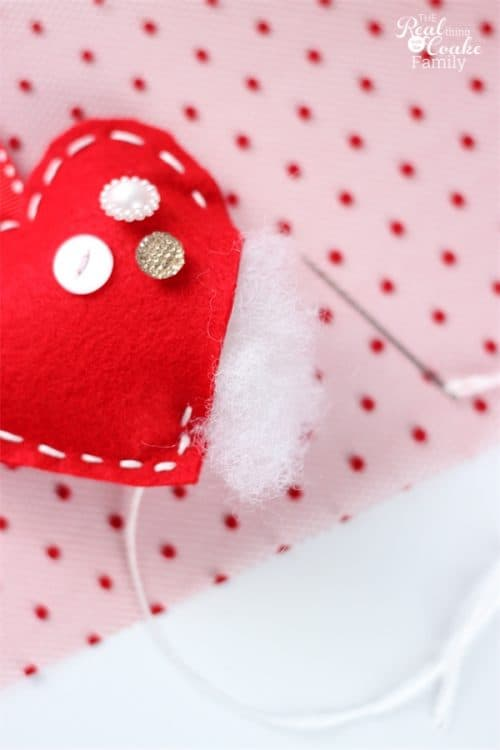 Valentine's Day crafts like this adorable garland for my home decor are so fun to make and look at. Can't wait to use this in my decorations this year!