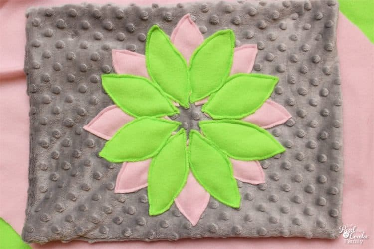 I love sewing Decorative Pillows. I get exactly what I want for my home decor and I save a ton of money. This is an adorable flower pillow! Perfect for a teen or girls bedroom.
