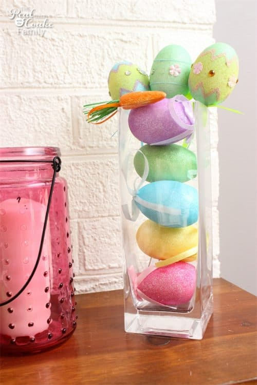 Such cute Easter Decorations for the mantel. I love the colors and the fun crafts to make this mantel. Need to add these to my Easter Ideas.