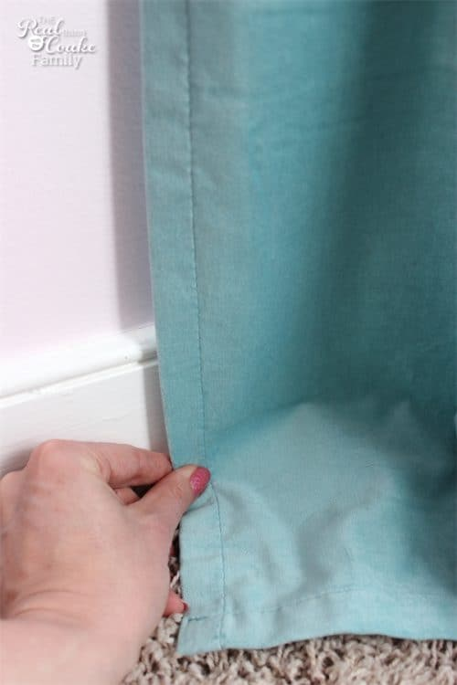 This is such a simple way to hem store bought curtains to the right length in 15 minutes. Perfect and Easy! I need to do this with the IKEA Curtains I got.