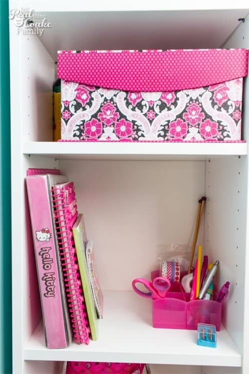 Love how organized these IKEA bookcases are. They make great a great way to organize and provide storage in this awkward kids room corner.