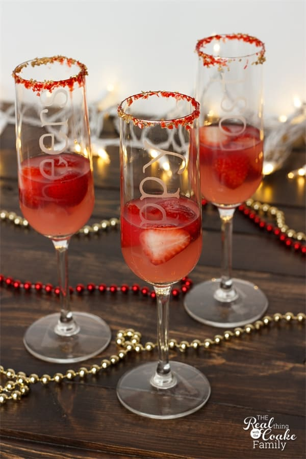 champagne flutes with sanding sugar, strawberries and pink lemonade