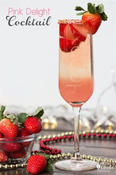 Pink wine cocktail in champagne flute with strawberry on top