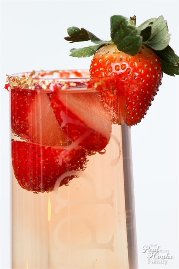 close up of strawberry on site of champagne flute