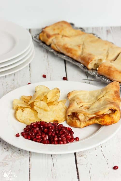 southwest Stromboli on a plate with chips and pomegranate seeds