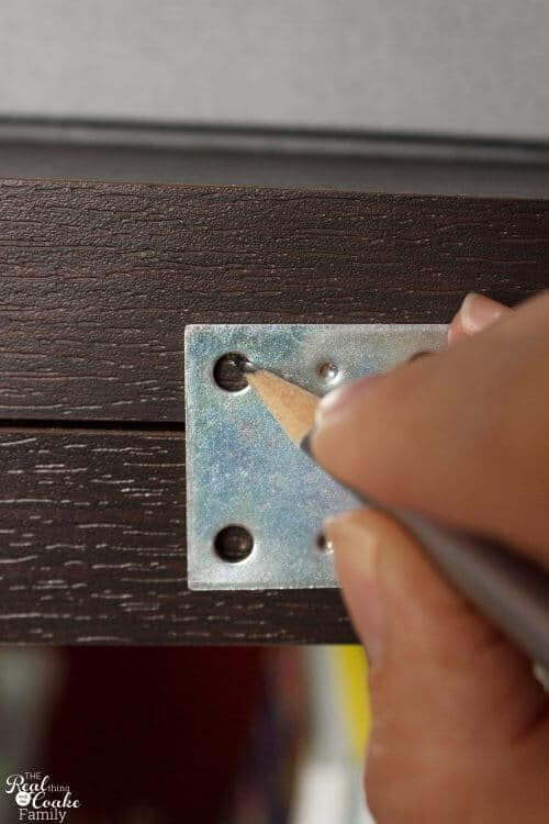 pencil marking where to drill for mending braces