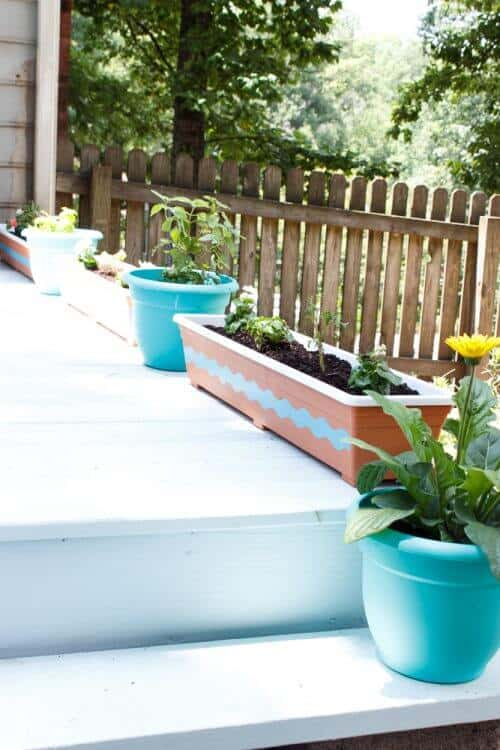 picture of painted pots on sky blue deck
