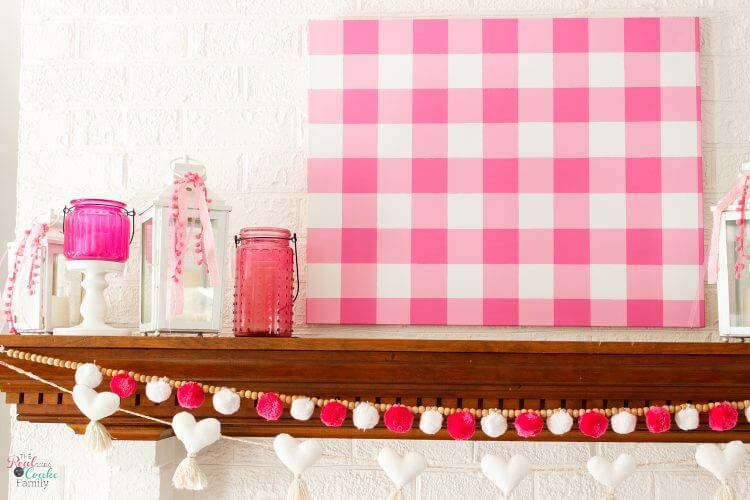 Step by step tutorial on how to paint gingham and make the cutest wall art out of a craft store canvas. Perfect craft project to make DIY wall art.