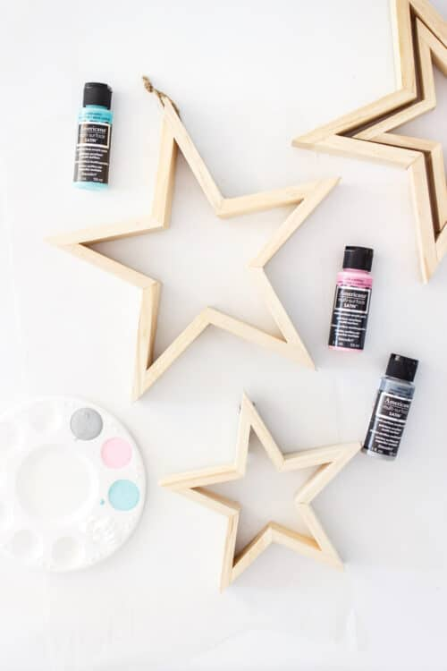 wood stars with paint and paint in paint tray