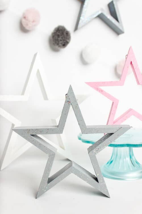 close up of white, gray, and pink glittery stars