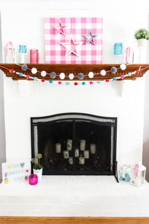 mantel picture showing pink, white, and gray 4th of July mantel