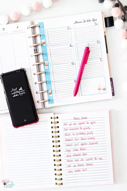 planner open to week with brain dump paper
