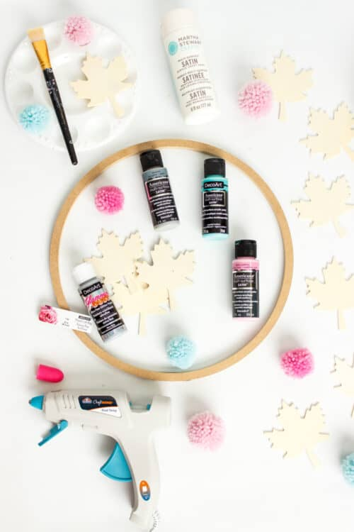 paint, hot glue, wood leaves and other supplies needed to make wreath