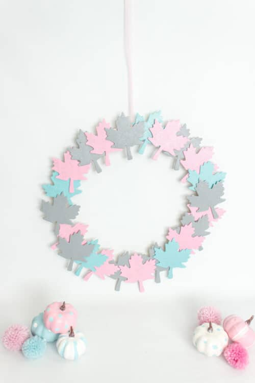 finished fall wreath with blue, pink and gray leaves