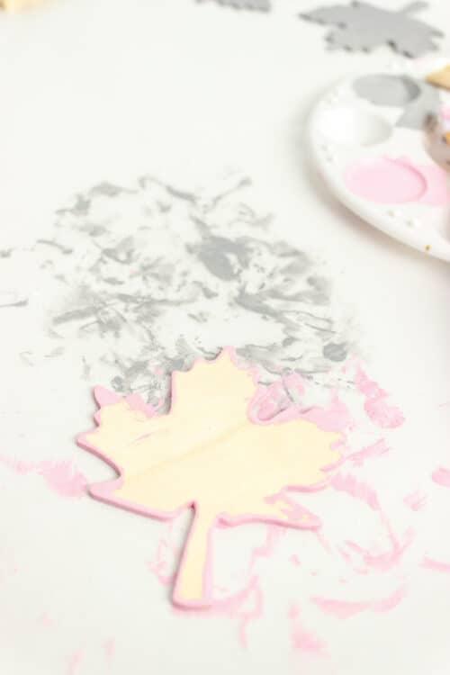 paint on edges of wood leaf