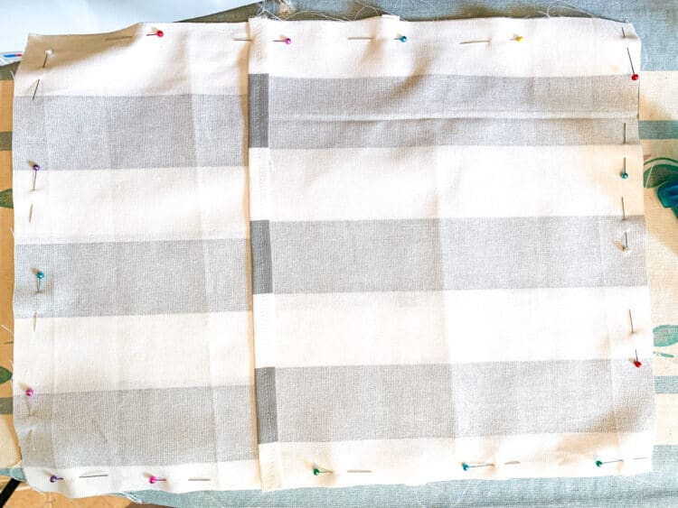 3 panels with pins pinning together for sewing