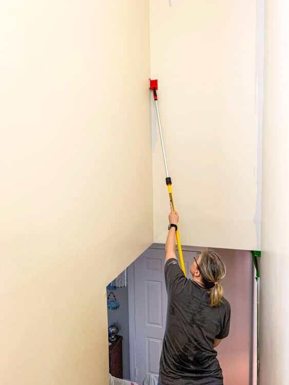 cutting in corners to paint a stairwell