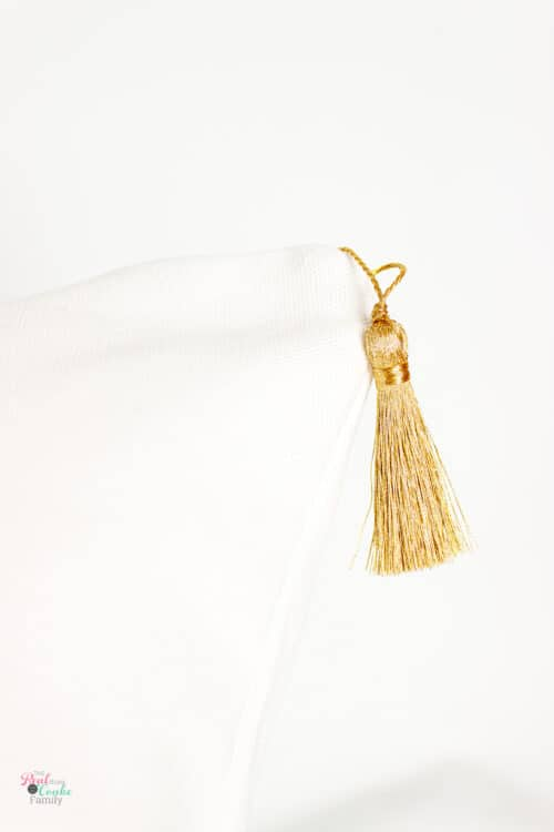 gold tassel on edge of Christmas pillow