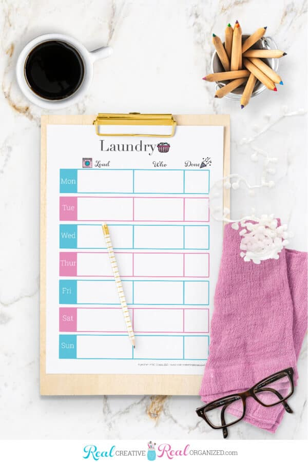 blank laundry schedule printable on clipboard