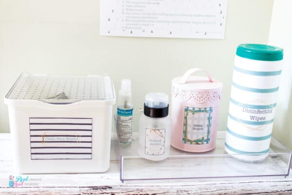 Close up of containers and printable to create sanitizing station