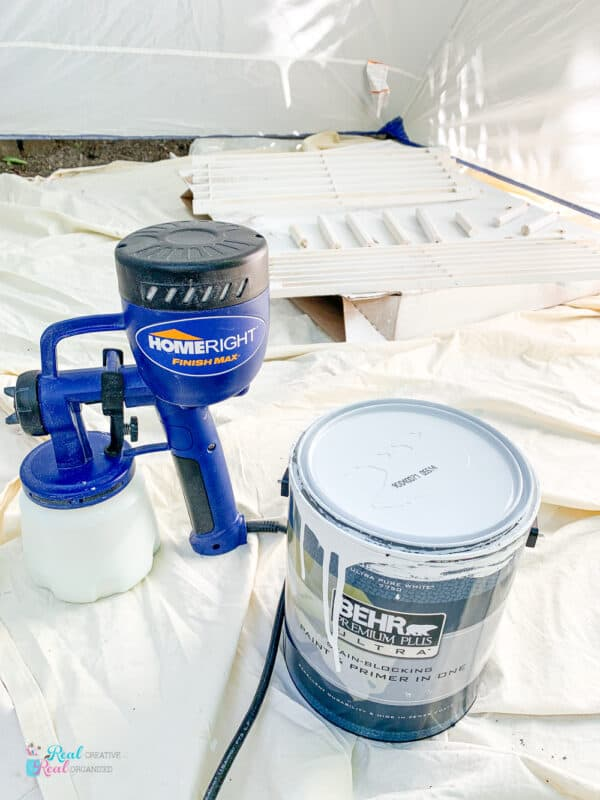 Can of paint and paint sprayer